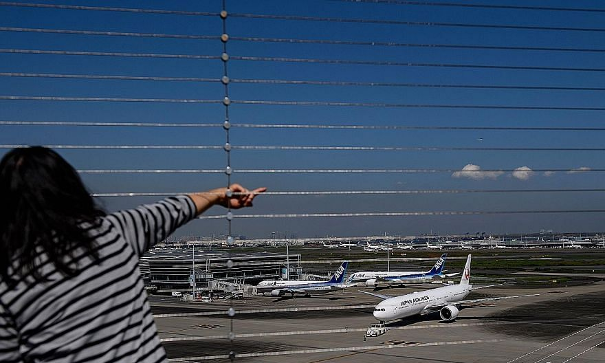 A view from the observation deck at Tokyo's Haneda airport early this month. Under the latest plan, the Japanese government is planning to relax curbs for business travellers from 30 nations and regions.