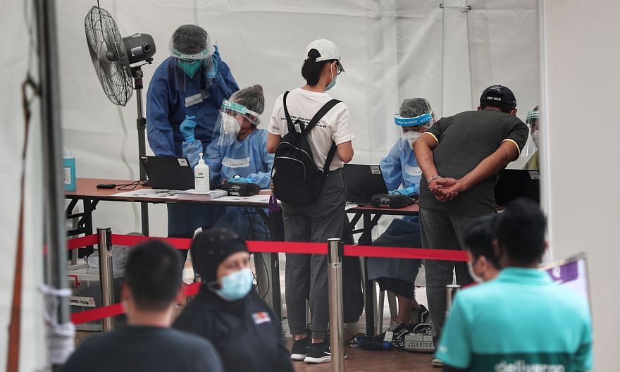 People queueing to take a Covid-19 swab test in Singapore last month. The writer says that the disease surveillance and health information systems being strengthened to track and report the coronavirus in various countries amid the pandemic must also