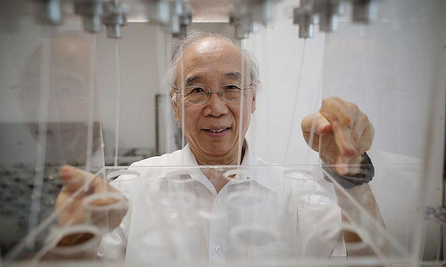 Professor Neal Chung from the National University of Singapore with the membranes being developed to separate carbon dioxide from the emissions of power plants. Research into carbon capture systems is gaining traction worldwide as nations seek to low