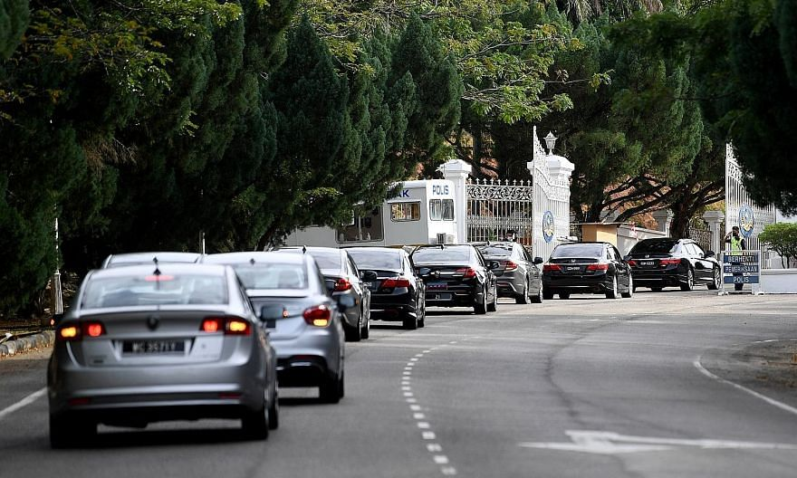 Malaysian Prime Minister Muhyiddin Yassin's motorcade arriving around 4.45pm yesterday at Istana Abdul Aziz in Kuantan for his meeting with the King to discuss imposing emergency measures.
