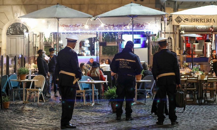 Italian police patrolling outside restaurants in Rome on Thursday. Italy and other European countries such as Austria, Croatia, Slovenia and Bosnia reported their highest single-day increases of Covid-19 cases on Thursday.
