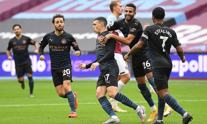 Phil Foden is congratulated by his Manchester City teammates after his equaliser in yesterday's draw at West Ham. Pep Guardiola's men could not deliver the knockout blow though and have now won just one of their last four league games.