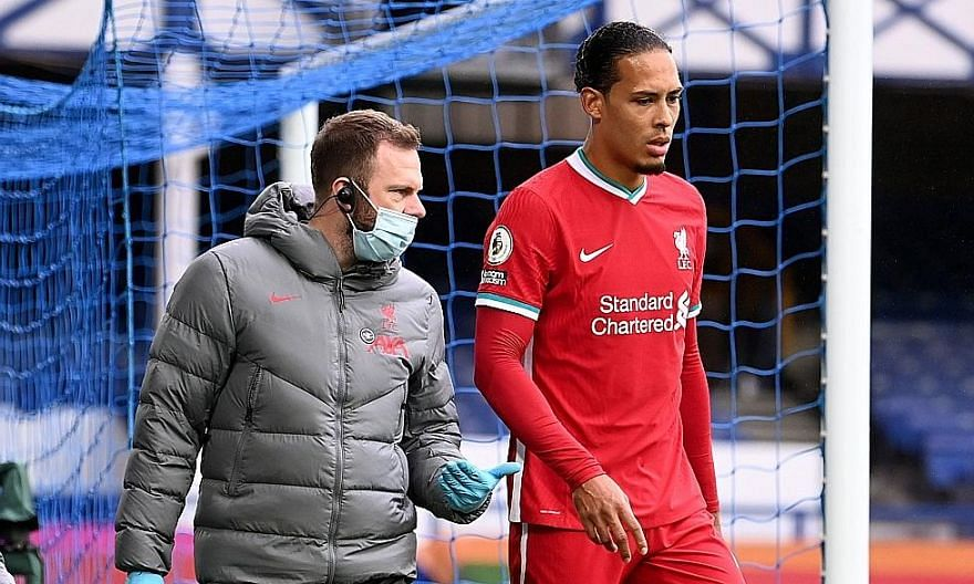 Liverpool's Virgil van Dijk limping off after his injury on Oct 17. He suffered a complete tear of his ACL after Everton goalkeeper Jordan Pickford's tackle in the 2-2 English Premier League draw.
