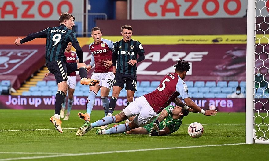 Patrick Bamford giving Leeds the lead against Aston Villa at Villa Park on Friday. The 27-year-old striker scored another two more, claiming his hat-trick in 19 second-half minutes. The 3-0 win ended the hosts' perfect record in the Premier League.