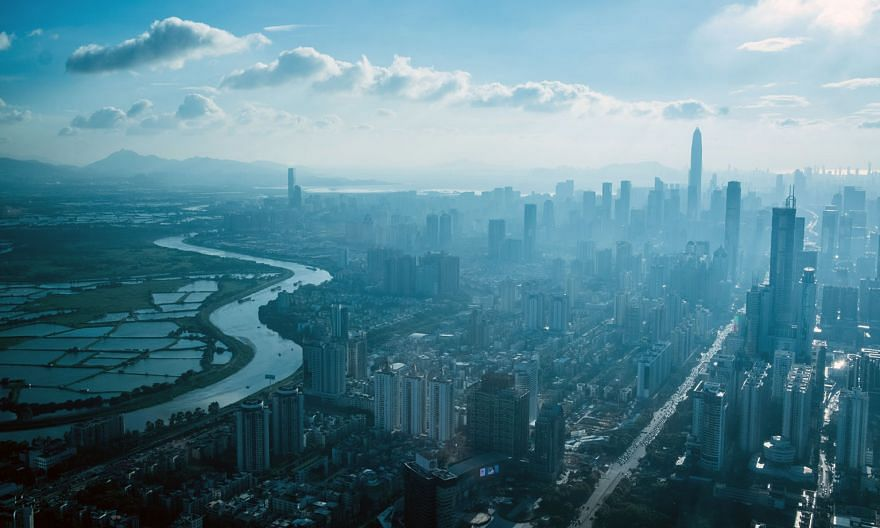 The Chinese city of Shenzhen (right) separated by a river from Hong Kong. Shenzhen was chosen as a special economic zone because of its proximity to shipping routes and Hong Kong, Macau and Taiwan. Its transformation from sleepy fishing village to tech an