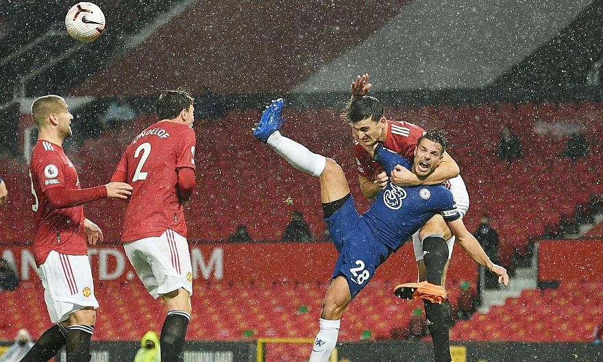Manchester United captain Harry Maguire hauling Chelsea defender Cesar Azpilicueta to the ground in the first half. The VAR checked the incident and found there was no clear and obvious error. PHOTO: REUTERS