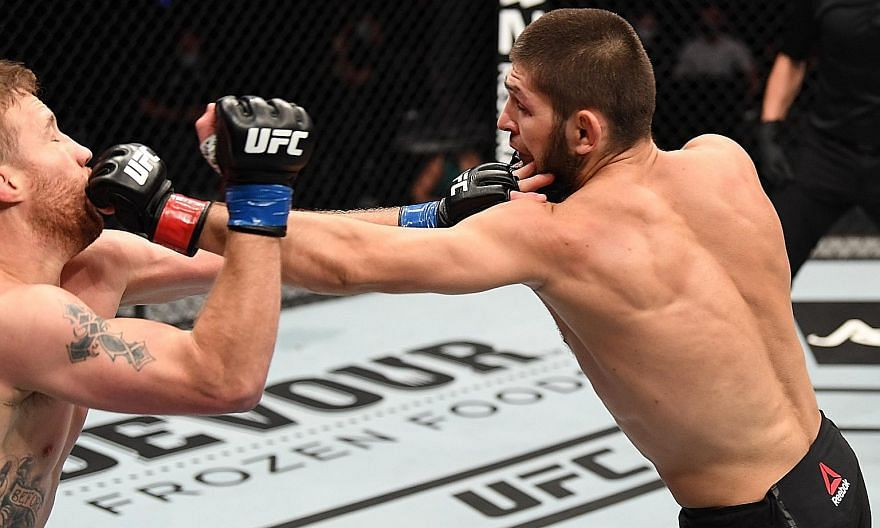 Russian Khabib Nurmagomedov punching Justin Gaethje in their lightweight title bout at UFC 254 in Abu Dhabi on Saturday. The American submitted barely two minutes into the second round. PHOTO: UFC