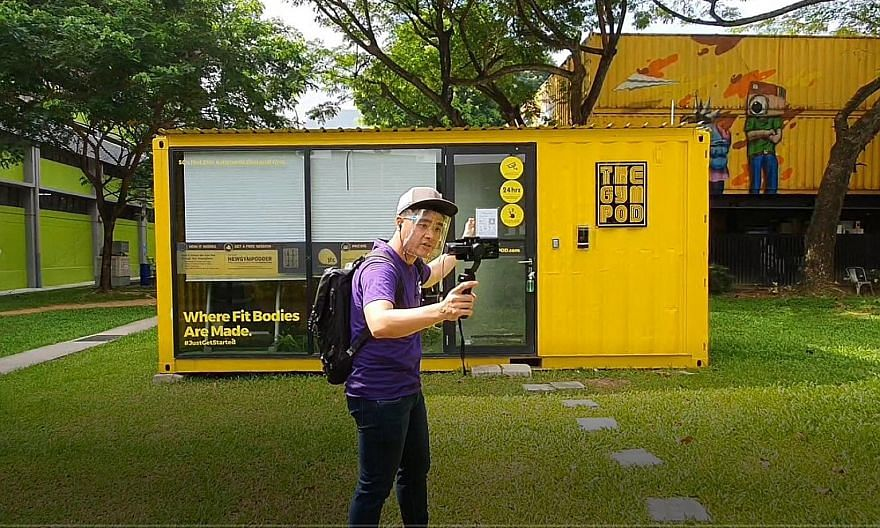 Monster Day Tours guide Byron Koh showing virtual tour participants around LaunchPad @ one-north, a precinct run by JTC Corporation for start-ups. Behind him is a gym operated by The Gym Pod. Twenty per cent of the tour participants are non-Singapore