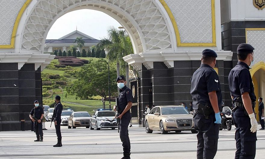The Sultan of Johor's motorcade leaving the Istana Negara in Kuala Lumpur after a meeting of the Malay rulers yesterday. Despite rejecting the emergency plan, the remarks from the palace yesterday appeared to endorse Malaysian Prime Minister Muhyiddi