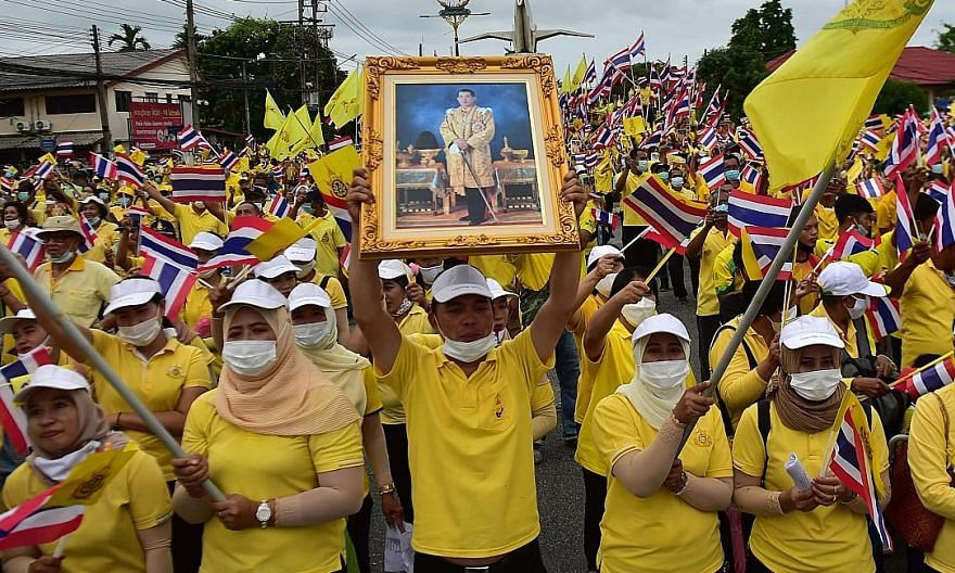 A royalist supporter with a portrait of Thailand's King Maha Vajiralongkorn in a mass rally to show support for the Thai royal establishment in Narathiwat province in southern Thailand yesterday. PHOTO: AGENCE FRANCE-PRESSE