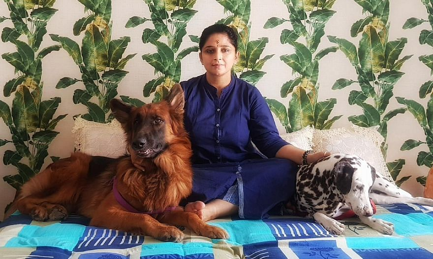 Ms Smita Sundararaman, who wound up her business in Gurgaon and moved to her home town of Lucknow in Uttar Pradesh, says her neighbour walks her two dogs every morning after she fractured her foot. PHOTO: KARAN SUNDARARAMAN