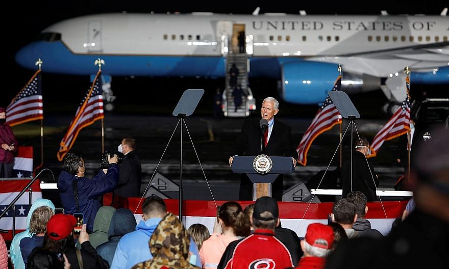 American Vice-President Mike Pence campaigning in Kinston, North Carolina, on Sunday. His chief of staff Marc Short as well as multiple aides have recently tested positive for the coronavirus. PHOTO: REUTERS