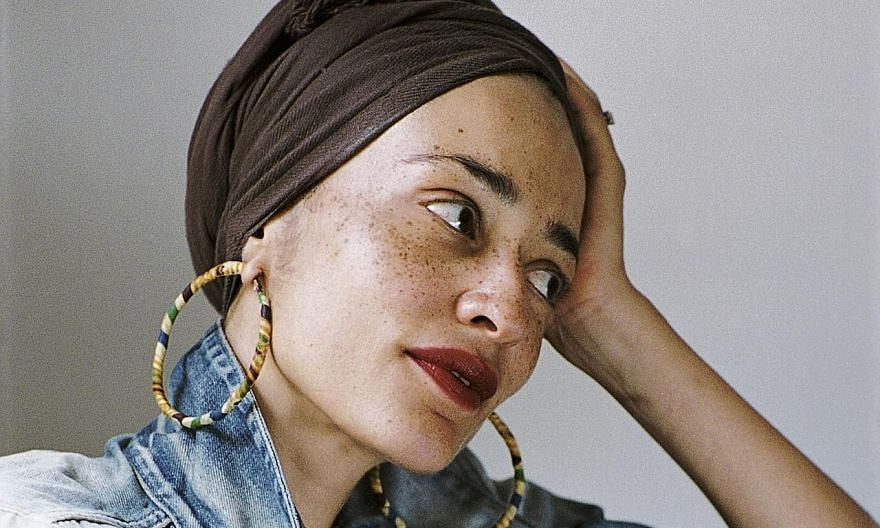 British writer Zadie Smith, a headliner at the Singapore Writers Festival, has been dealing with the unbearable present by escaping to the past - by means of the historical novel she is writing.