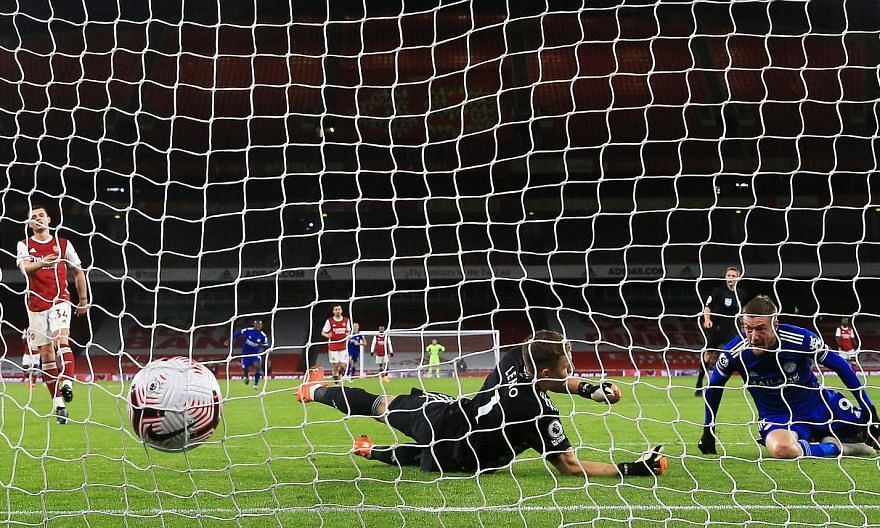 Leicester striker Jamie Vardy scoring past Arsenal goalkeeper Bernd Leno in the 1-0 Premier League victory in London on Sunday. The Foxes are now fourth in the standings. PHOTO: EPA-EFE
