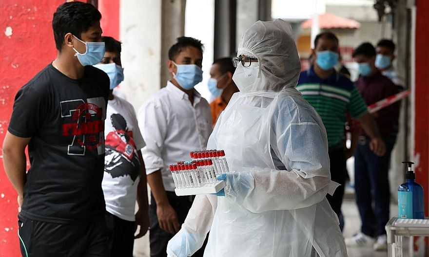 A medical worker preparing to administer coronavirus swab tests outside a clinic in Kajang, Selangor, yesterday. Malaysia saw 1,240 Covid-19 cases yesterday, with seven new fatalities, bringing the total to 27,805 cases with 236 deaths. PHOTO: REUTER