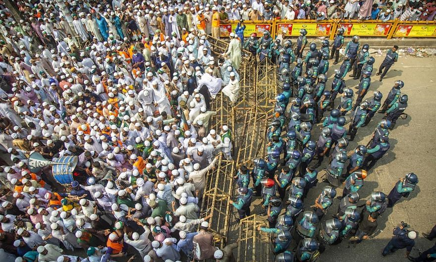 The police stopping members of a Bangladeshi Islamist party with a barricade during a march towards the French Embassy in Dhaka yesterday.