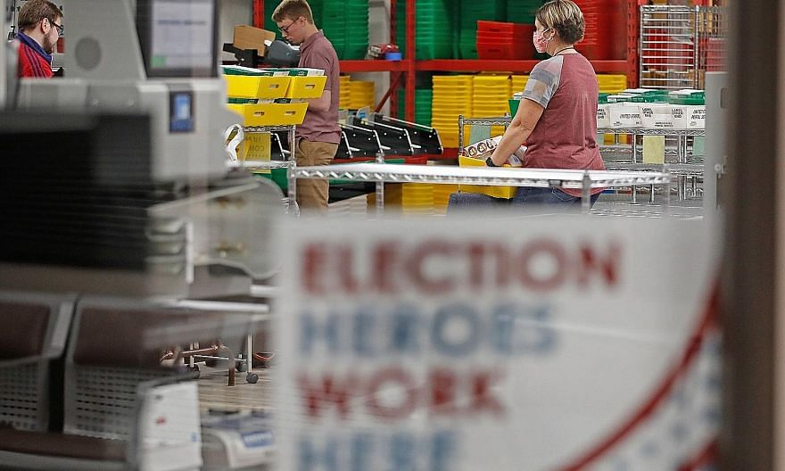 Election workers processing ballot envelopes in Utah on Monday. Utah is one of several states that have moved to mail-in ballots for the Nov 3 presidential election. Given that more Democrat than Republican voters are requesting mail-in ballots, it i