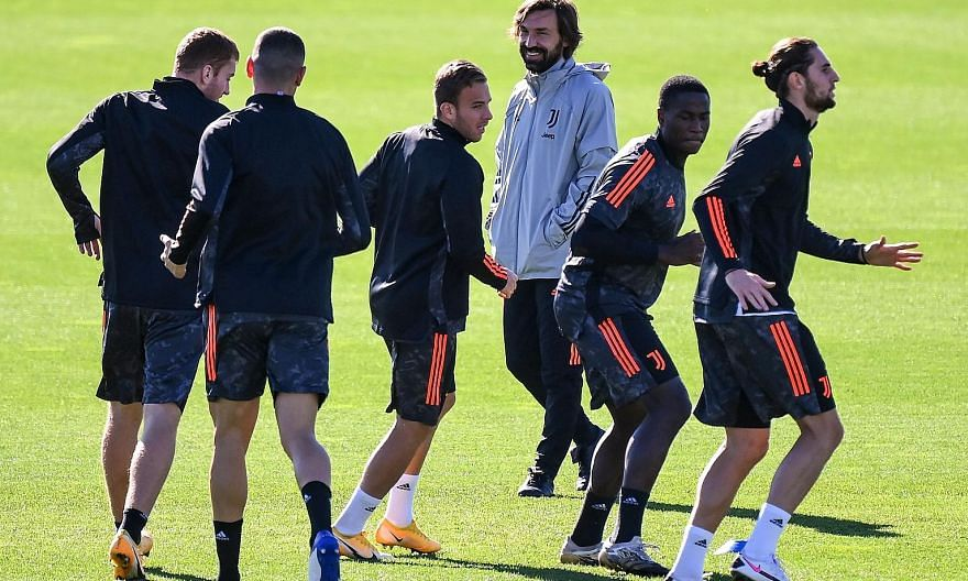 Andrea Pirlo overseeing training as the Italian champions prepare to take on Barcelona.