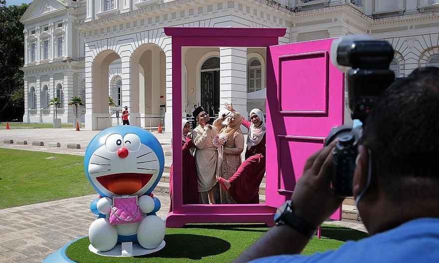 Doraemon figures as well as an Anywhere Door (main picture) on the front lawn of the National Museum of Singapore. (Above) The Doraemon installation has been curated with highlights of the museum's collections from the 1960s through to the 1980s.
