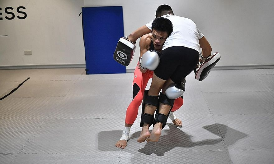 Above: Tiffany Teo in 2018. Left: Teo, shorn of her long locks, grappling with her trainer. She will attempt to become the first Singaporean world champion in One Championship when she takes on Xiong Jingnan on Friday for the Chinese fighter's straww