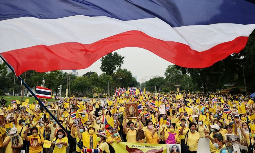 Thai royalists demonstrating in Bangkok yesterday in support of King Maha Vajiralongkorn. So far, royalist demonstrations have been considerably smaller than the tens of thousands of people who have joined the biggest protests against the government,