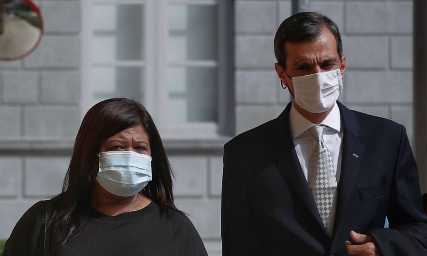 Ms Parti Liyani, seen here with her lawyer Anil Balchandani, is seeking compensation from the Attorney-General's Chambers. ST PHOTO: JASON QUAH