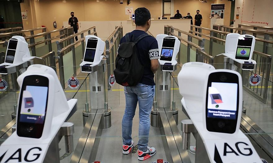 The Immigration and Checkpoints Authority's new iris and facial feature recognition technology at Woodlands Checkpoint. An iris scan provides almost 250 feature points for matching, as compared with about 100 points for a fingerprint. The facial scan
