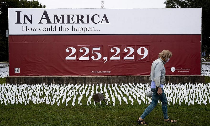 A memorial at the D.C. Armory parade ground in Washington, DC on Tuesday, with a sign showing a recent figure representing the number of people in the United States who had died of Covid-19. The disease has killed more than 226,000 people in the US s