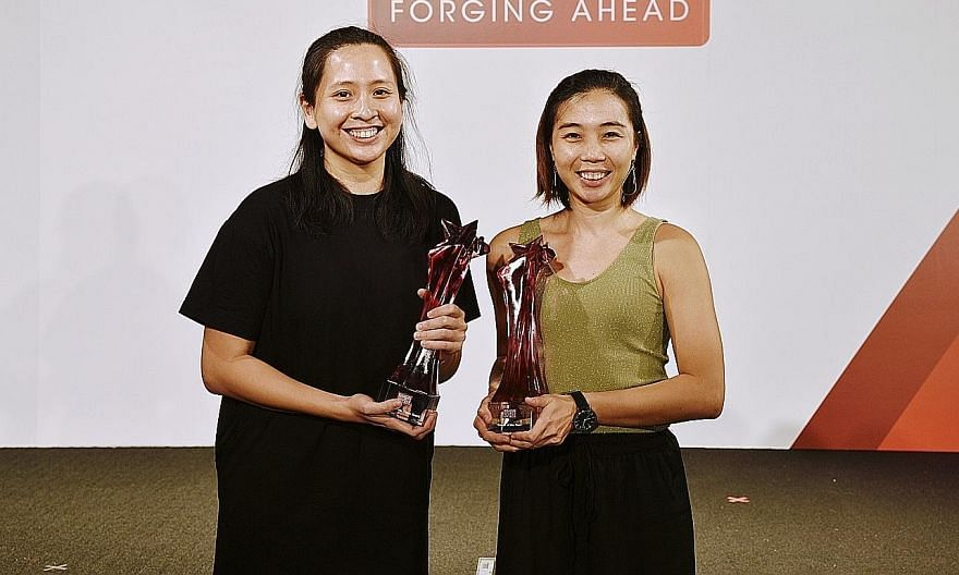 Coach of the Year Louise Khng (far right) and floorball former co-captain Debbie Poh with their trophies at the Singapore Sports Awards yesterday.