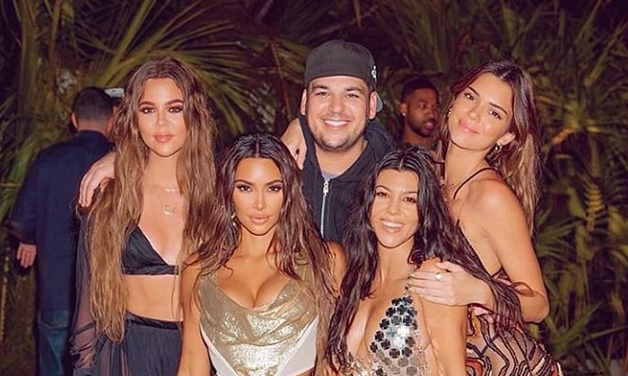 Kim Kardashian (front row, left) chartered a private jet to fly her entourage to a remote tropical island for a lavish 40th birthday celebration last week.