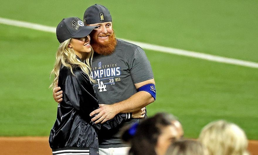 Justin Turner celebrating the LA Dodgers' World Series win with his wife Kourtney Pogue on Tuesday. Turner was back on the field after the game, having been withdrawn midway through the eighth inning after MLB learnt he had tested positive for the co