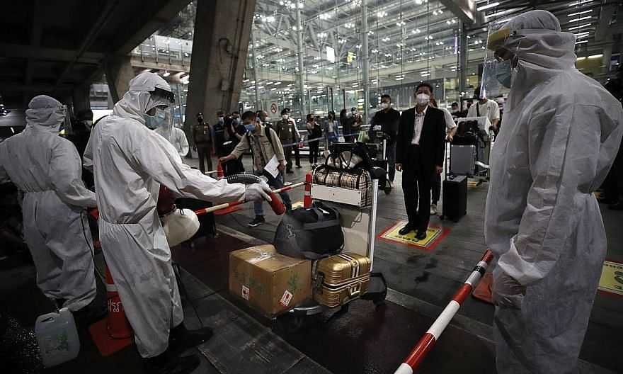 Thai health officials disinfecting the luggage of travellers from China at Bangkok's Suvarnabhumi Airport last week. Thailand was among the top destinations for Chinese travellers last year.