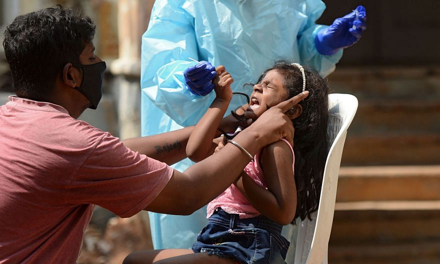 A girl being swabbed for Covid-19 at a centre in Hyderabad, Telangana, yesterday. India has one of the world's lowest death rates and the government has highlighted the slowing number of new infections in recent weeks. But Prime Minister Narendra Modi has