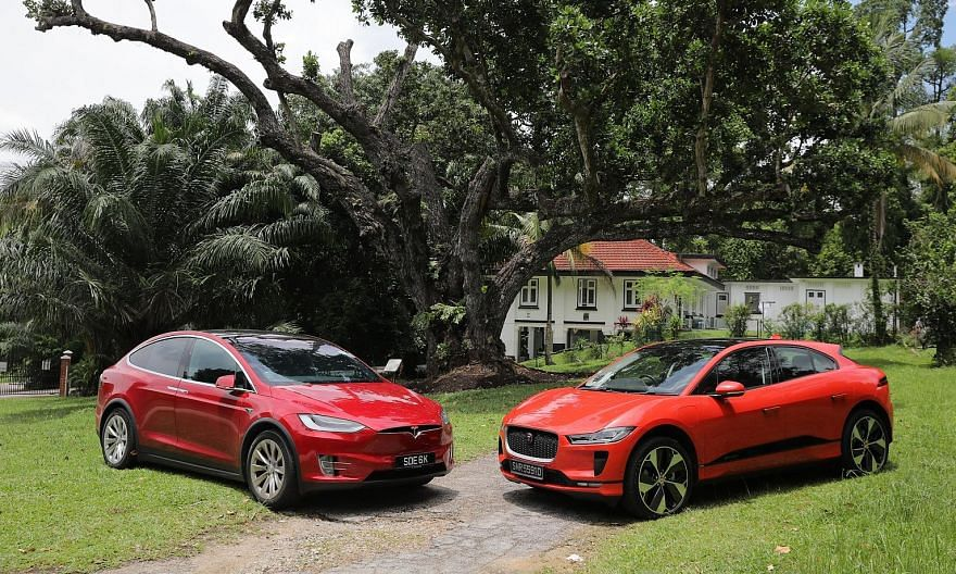 The Tesla Model X (above, left) and the Jaguar I-Pace (above, right). The Tesla Model X has a 17-inch portrait-style touchscreen, on which you can access a full suite of settings and ancillary controls. The Jaguar I-Pace's centre console retains phys