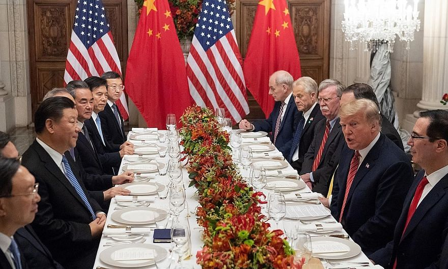 US President Donald Trump meeting his Chinese counterpart Xi Jinping in Buenos Aires, Argentina, in December 2018. PHOTO: AGENCE FRANCE-PRESSE