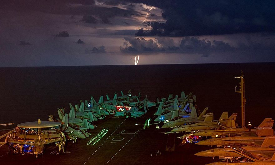 The USS Nimitz aircraft carrier in the South China Sea in July. The United States has rejected most of China's claims to contested waters there. PHOTO: REUTERS