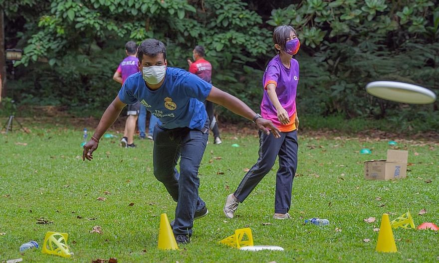Migrant worker Rajagopal Purusothaman taking part in an activity at Bukit Batok Nature Park yesterday. The activities for a mixed group of 25 people, including nine migrant workers, were part of a pilot initiative by volunteer-run campaign Welcome In