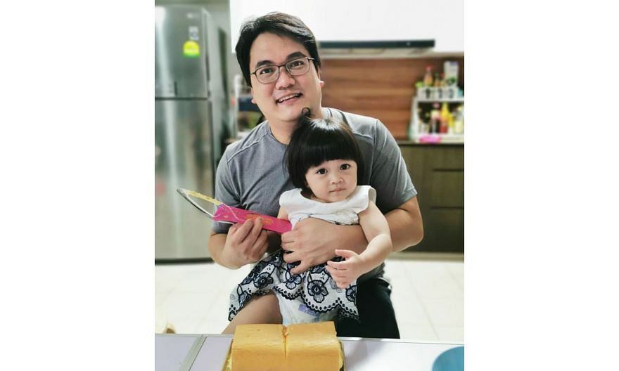 Mr Gregory Chua, 32, who used to work as a research associate specialising in 3D printing, has found a new career as a senior additive manufacturing engineer at local engineering firm 3D Metalforge. He is seen here with his two-year-old daughter Eric