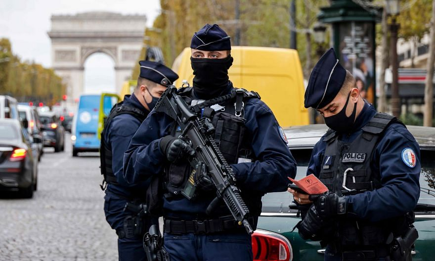 Police officers on the Champs-Elysees avenue in Paris yesterday, the first day of a national Covid-19 lockdown. President Emmanuel Macron has increased the number of soldiers mobilised from 3,000 to 7,000 to protect important sites such as places of