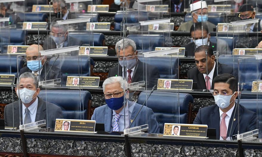 Malaysia's Defence Minister Ismail Sabri Yaakob (front, centre) and International Trade and Industry Minister Azmin Ali (right), in Parliament yesterday before the sitting was adjourned. PHOTO: MALAYSIA'S DEPARTMENT OF INFORMATION