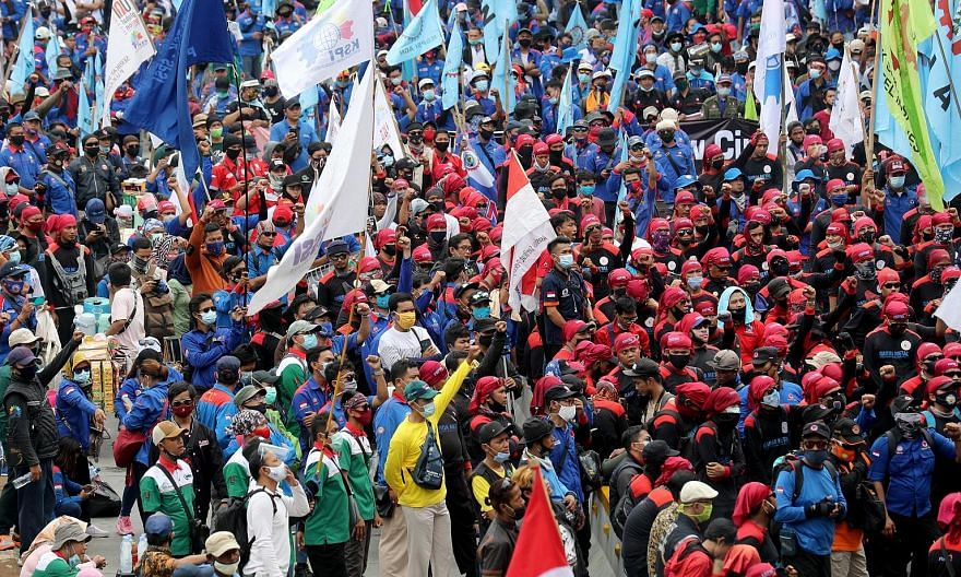 Indonesian labourers taking part in a rally against the new law in Jakarta on Monday.