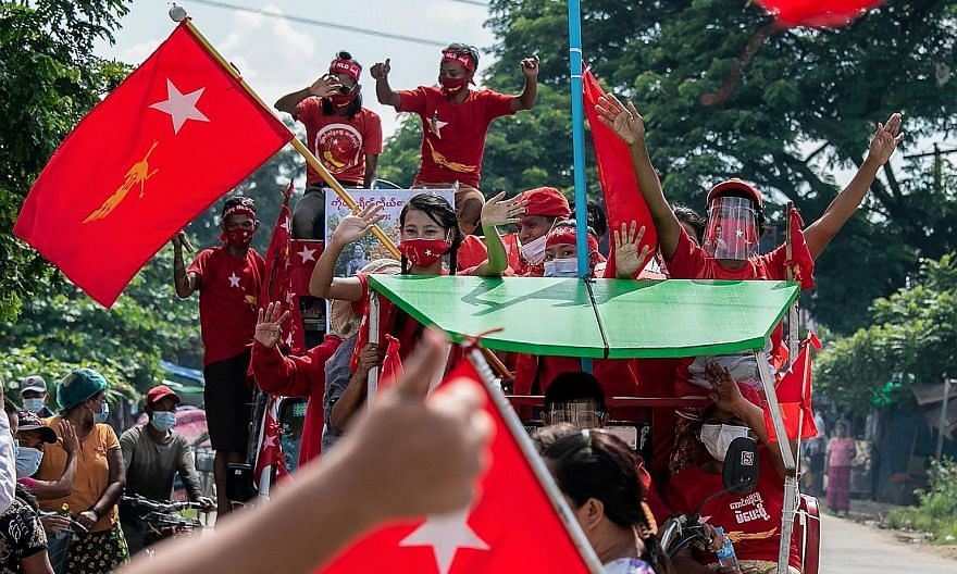National League for Democracy party supporters (above) at a campaign rally in Yangon on Oct 25. The party's winning formula largely leans on the charisma and influence of party leader and state counsellor Aung San Suu Kyi (below) and its 2020 electio