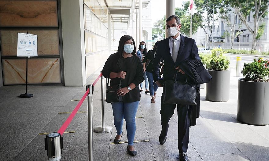 Ms Parti Liyani and her lawyer Anil Balchandani arriving at the Supreme Court last month. Workers' Party chairman Sylvia Lim said Ms Parti's case raised the question of whether Singapore's justice system puts everyone on an equal footing. ST PHOTO: J