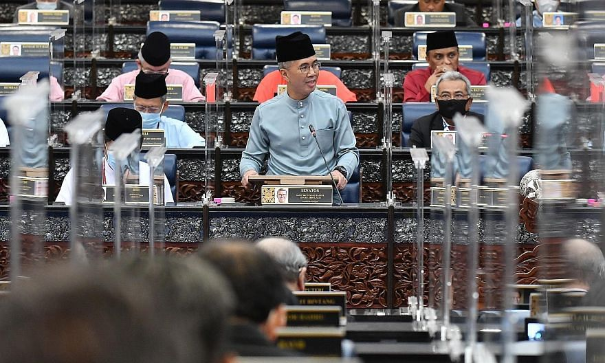 Malaysian Finance Minister Tengku Zafrul Aziz presenting Budget 2021 in Parliament in Kuala Lumpur yesterday. Prime Minister Muhyiddin Yassin had said earlier this week that his administration's first budget will be expansionary, in line with biparti