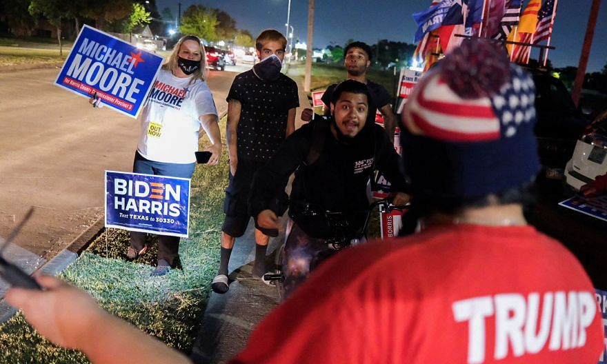Supporters of Mr Joe Biden and Mr Michael Moore, a Democrat who was running in a county election in Texas, in a face-off with pro-Trump supporters outside a polling site in Houston on election night on Tuesday. PHOTO: REUTERS