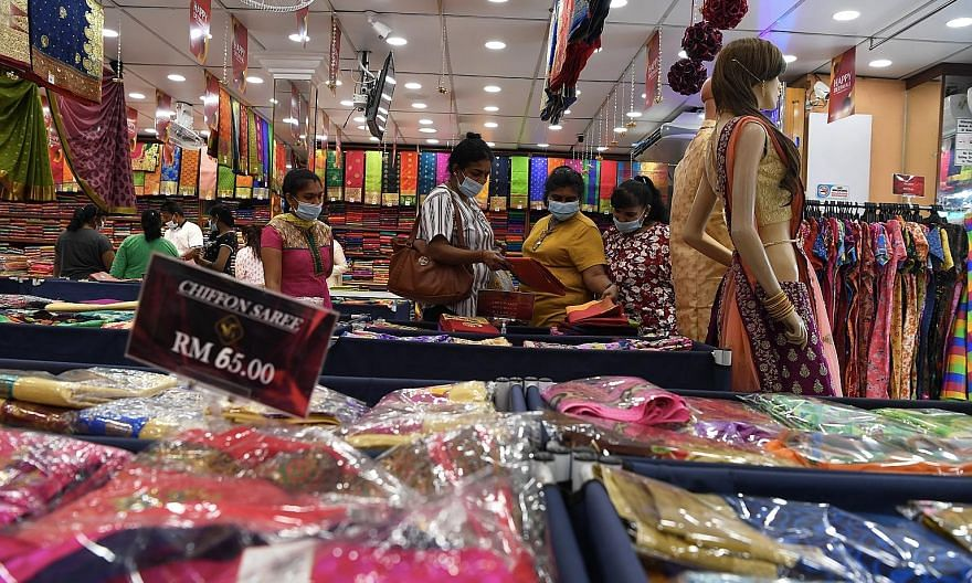 Hindus in the Malaysian state of Penang shopping for Deepavali yesterday. This year, the festival falls on Nov 14, with the country in the grip of a conditional movement control order that will curtail celebrations somewhat. PHOTO: BERNAMA