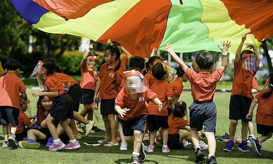Pre-schoolers from Maple Bear playing games to raise funds for Make-A-Wish Foundation and Children's Wishing Well. Social distancing rules meant activities had to be confined within each pre-school centre. PHOTO: MAPLE BEAR SINGAPORE