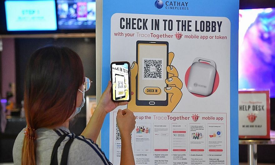 A moviegoer using the TraceTogether app to scan a QR code to check in at a Cathay cinema on Oct 31. Most users are not conscious of the dangers associated with QR codes, but the app is able to validate them. ST PHOTO: CHONG JUN LIANG