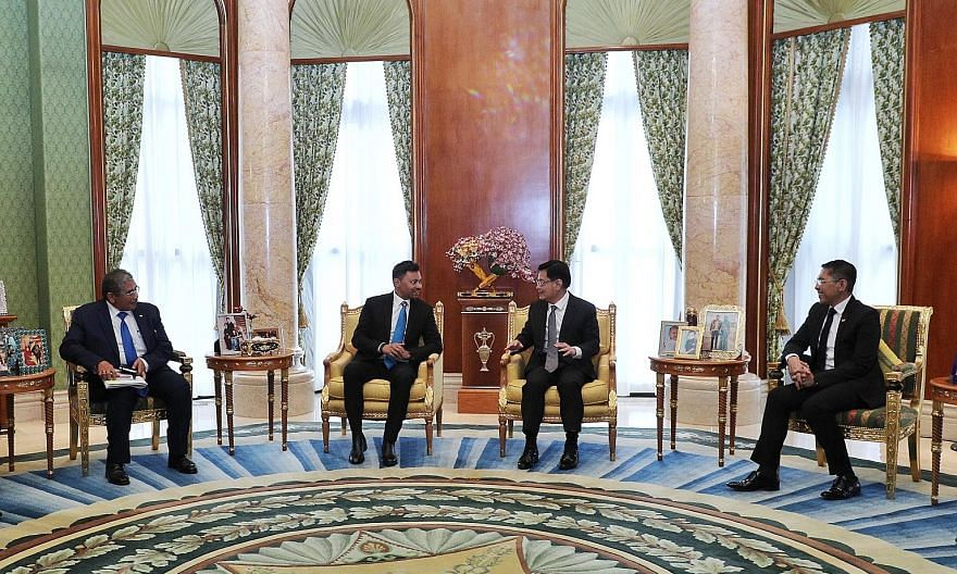 Deputy Prime Minister Heng Swee Keat meeting Crown Prince Al-Muhtadee Billah (both centre) in Brunei yesterday. With them were Dr Maliki Osman (right), Minister in the Prime Minister's Office of Singapore, and Brunei's Second Foreign Minister Erywan