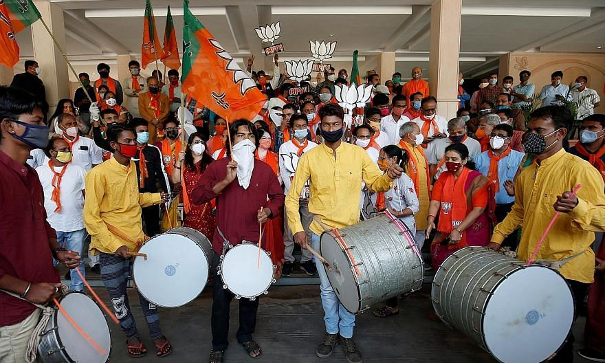 Supporters of India's ruling Bharatiya Janata Party (BJP) in the city of Gandhinagar in Gujarat state celebrating yesterday after initial results in the Bihar state assembly election show the BJP to be doing well.